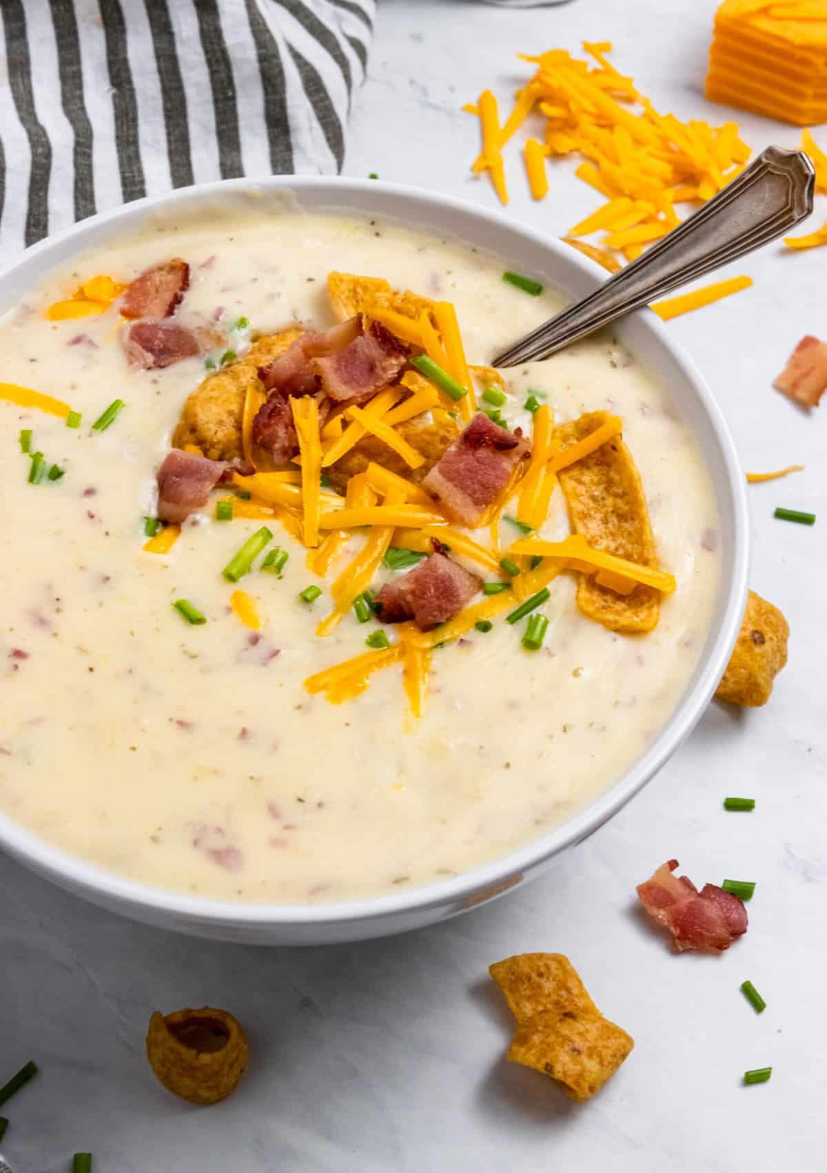 Bowl of Instant Pot Potato Leek Soup with spoon.