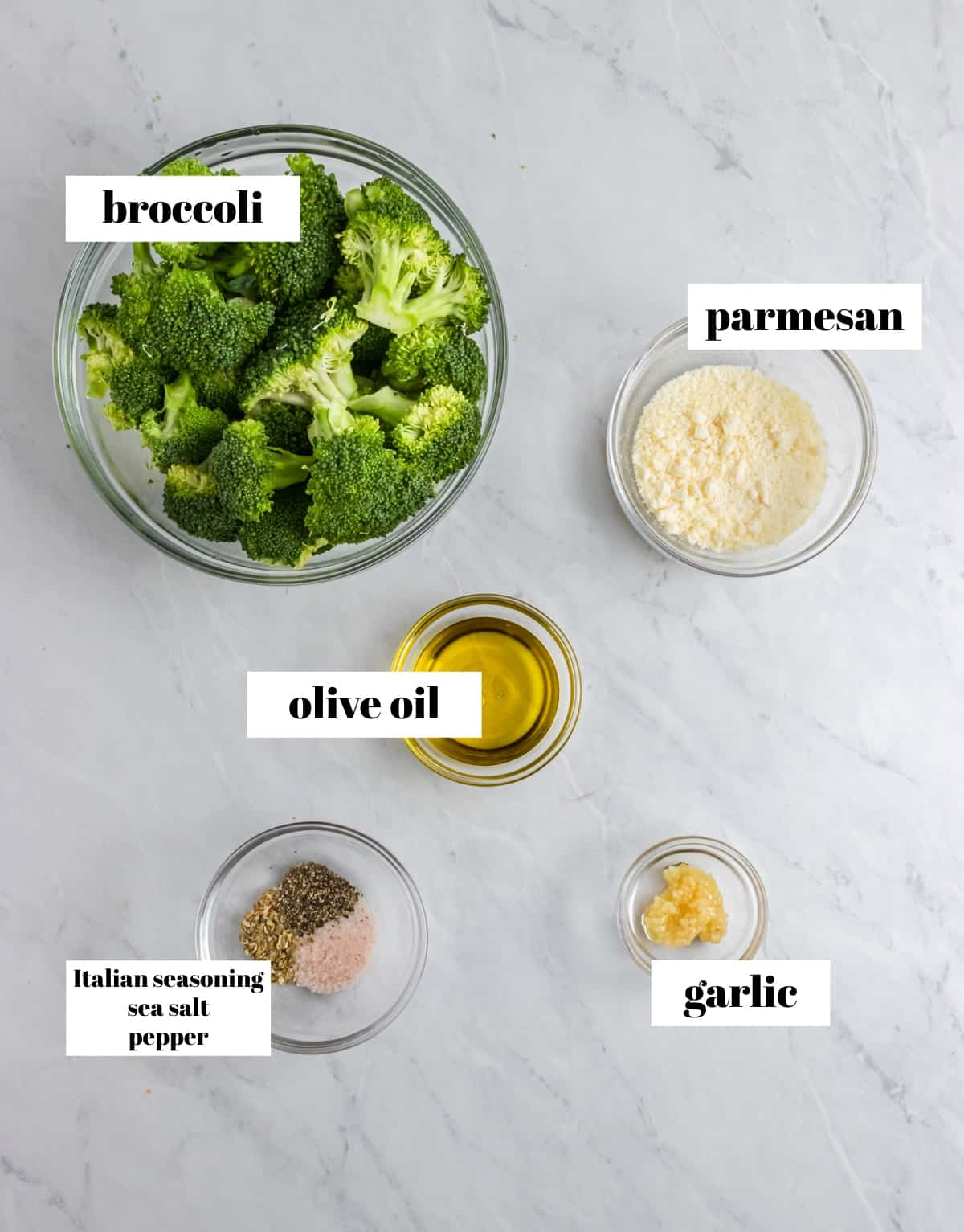 Broccoli, garlic, olive oil and ingredients labeled on counter.