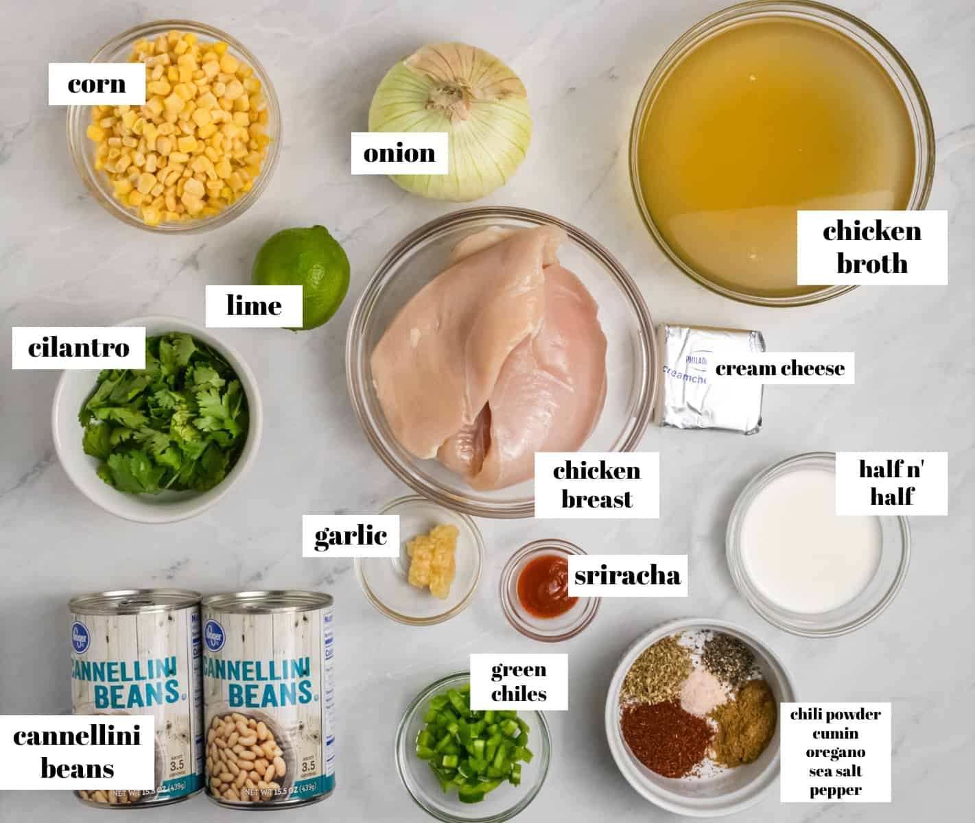 Chicken, cilantro, cream cheese, broth, beans etc. on counter labeled.