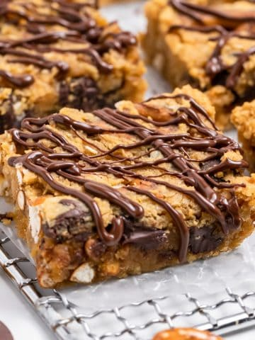Chickpea blondies on cooling rack with chocolate drizzle.
