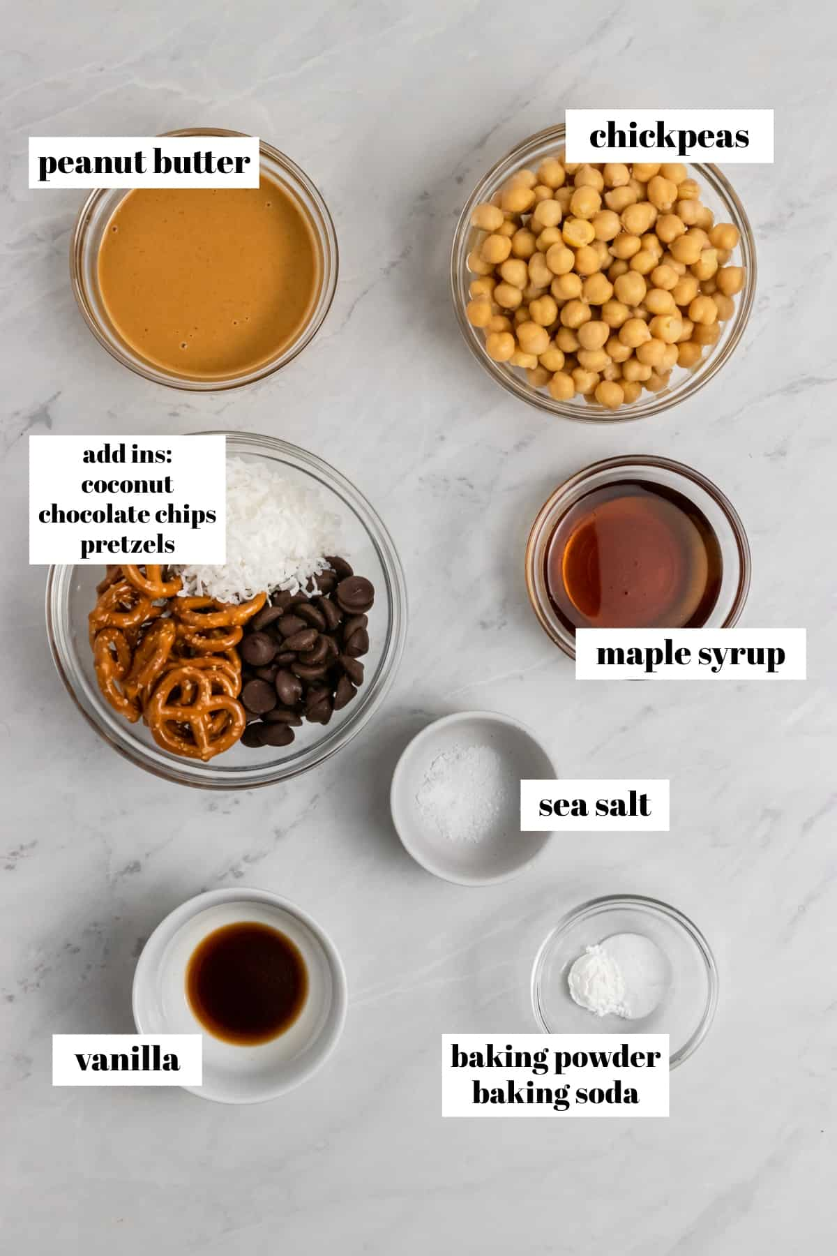 Chickpeas, peanut butter, maple and ingredients labeled on counter.