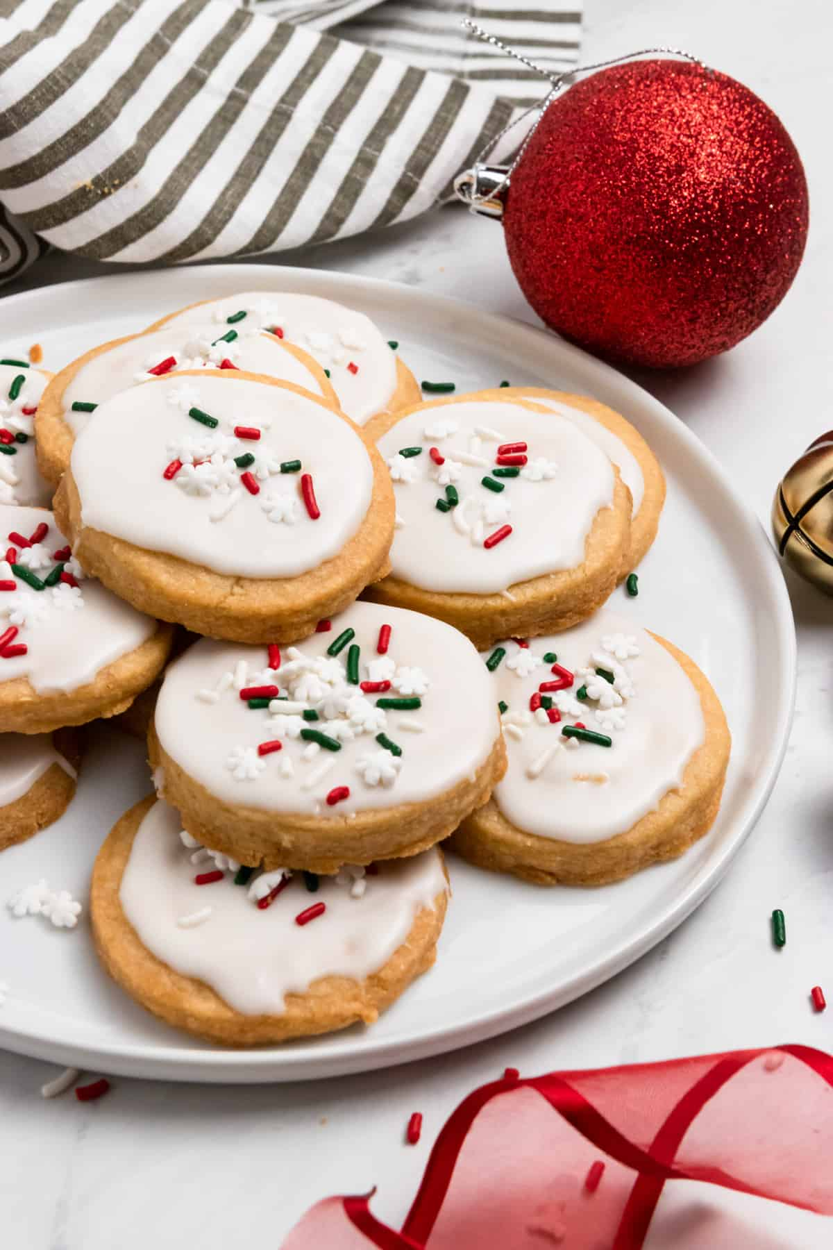 Christmas shortbread cookies on plate with red and green sprinkles.
