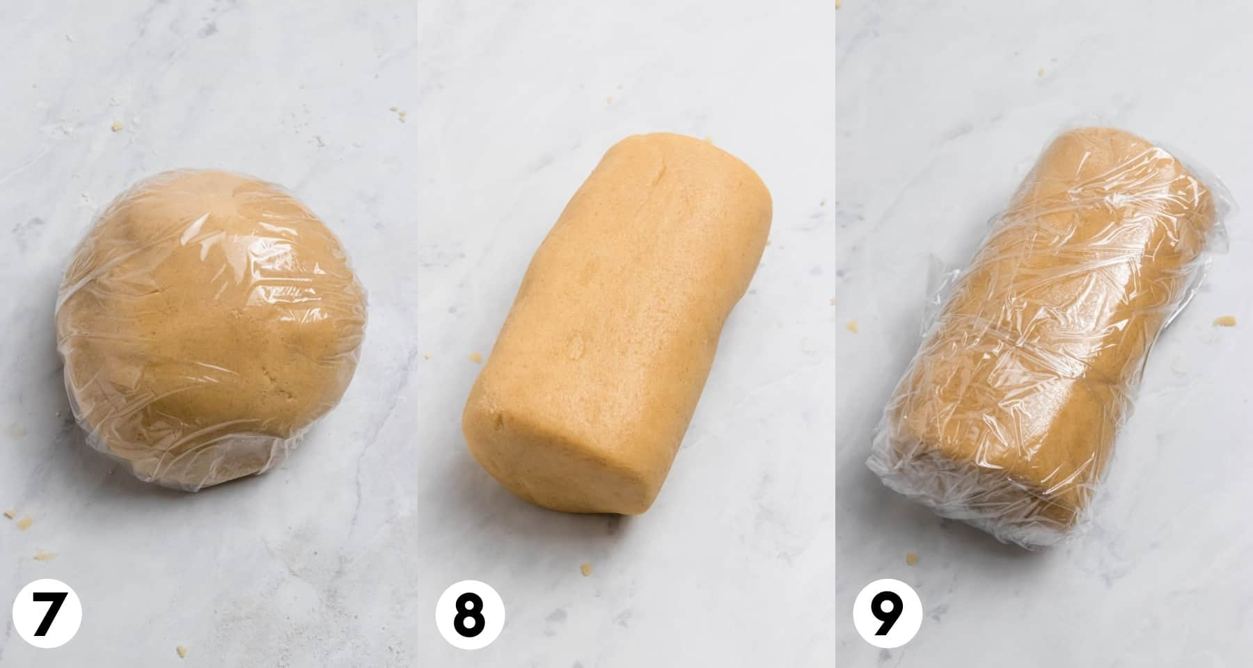 Cookie dough rolled and then covered in plastic wrap.
