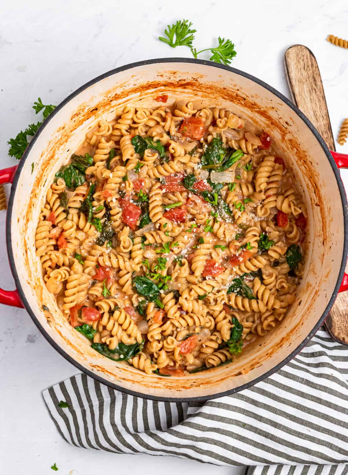 Easy creamy one pot pasta in pot with spoon.