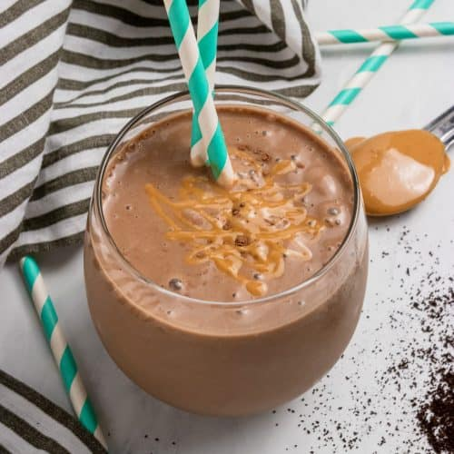 Peanut butter coffee smoothie in cup with straw.