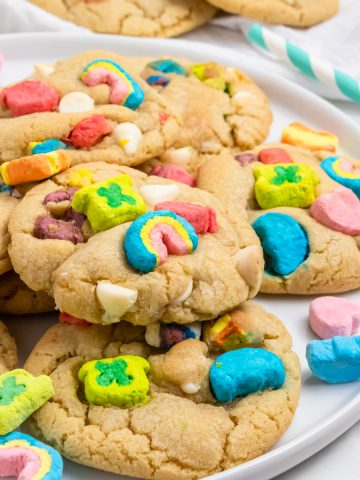 Lucky Charm Cookies on white plate with marshmallows.