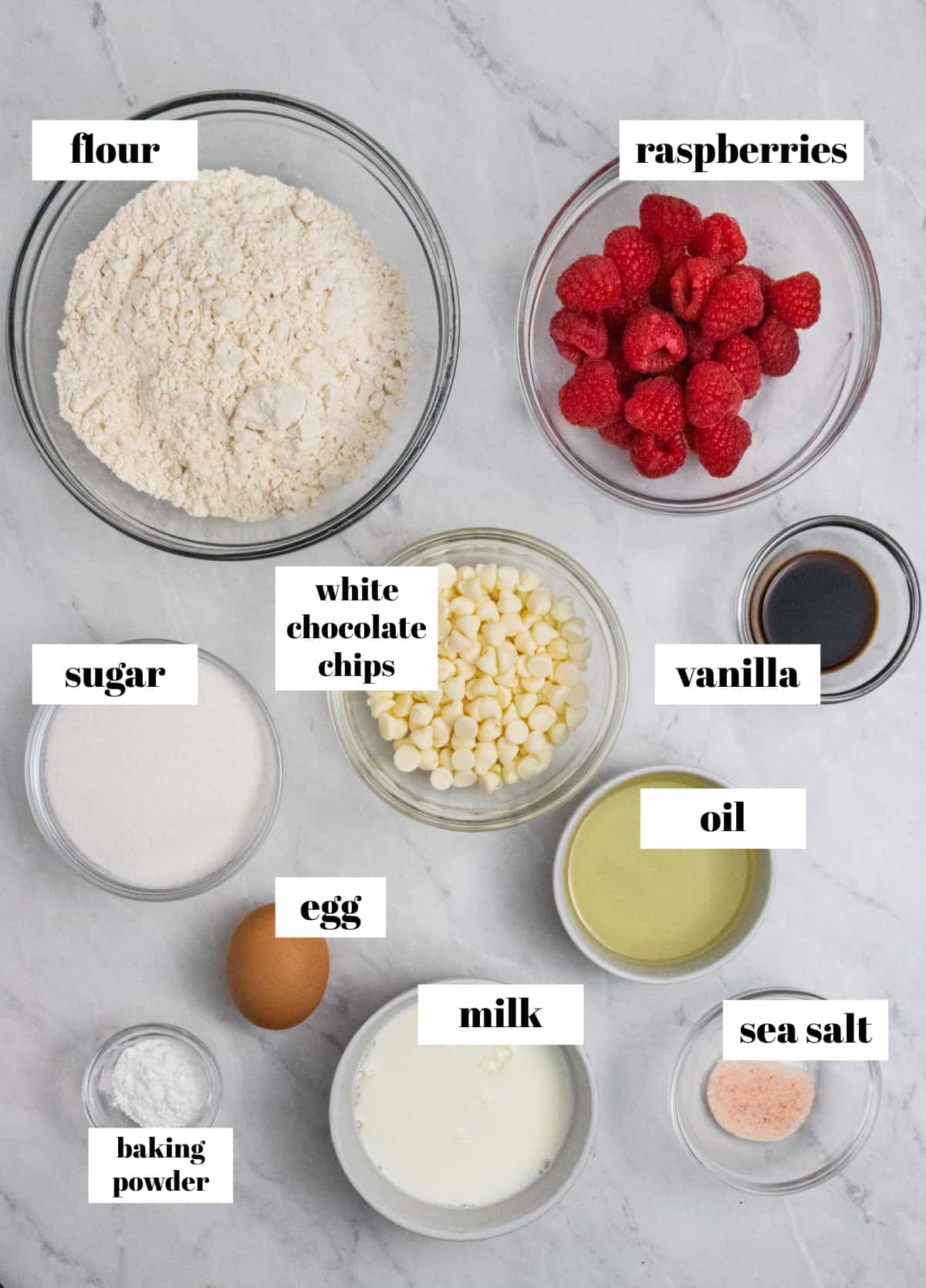 Flour, sugar, oil and other ingredients labeled on counter.