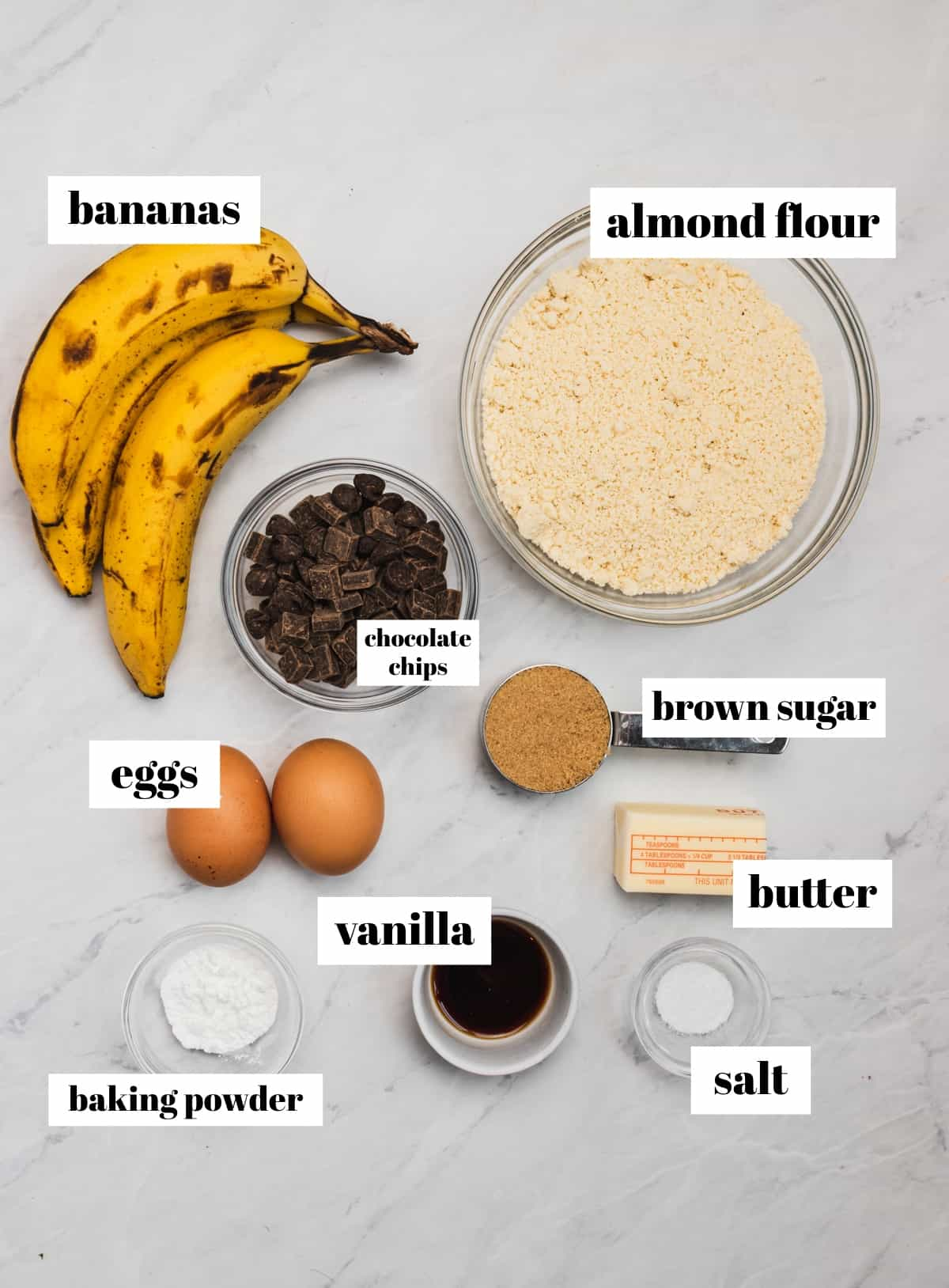 Butter, baking powder, bananas, brown sugar and other ingredients labeled on counter.