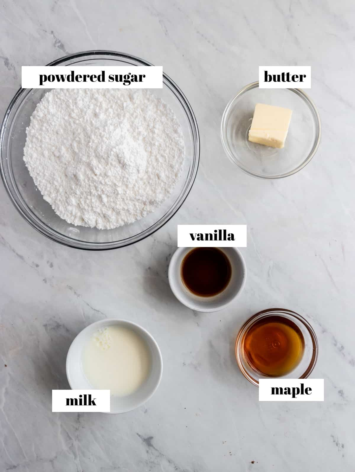 Powdered sugar, butter, maple and other ingredients for icing.
