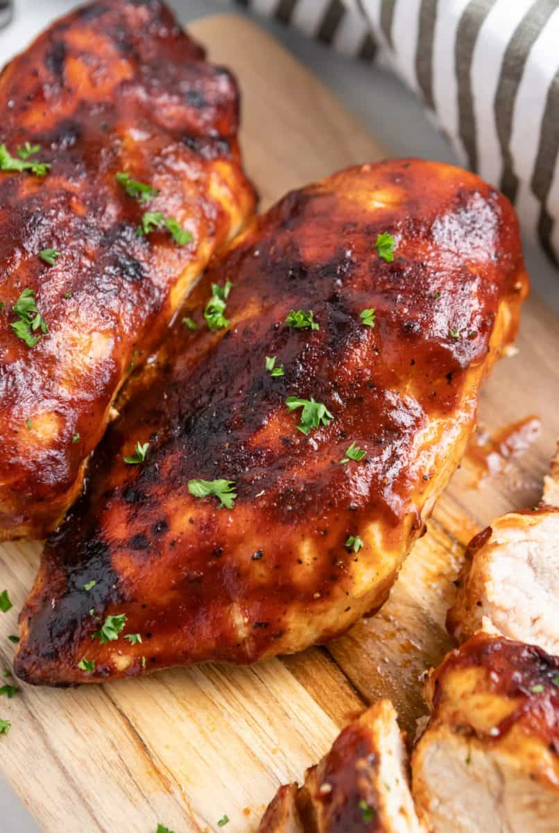 Chicken on cutting board with parsley.