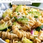 Grilled zucchini pasta salad with corn and parmesan in bowl.