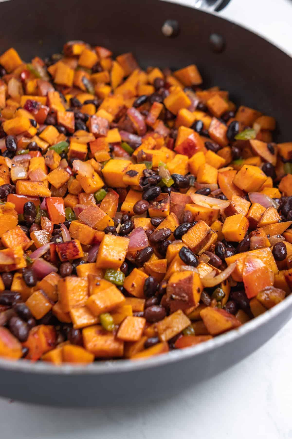 Black beans added into sweet potato skillet breakfast hash.