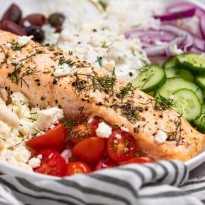Salmon rice bowl with tomatoes, cucumbers, kalamata olives, etc.