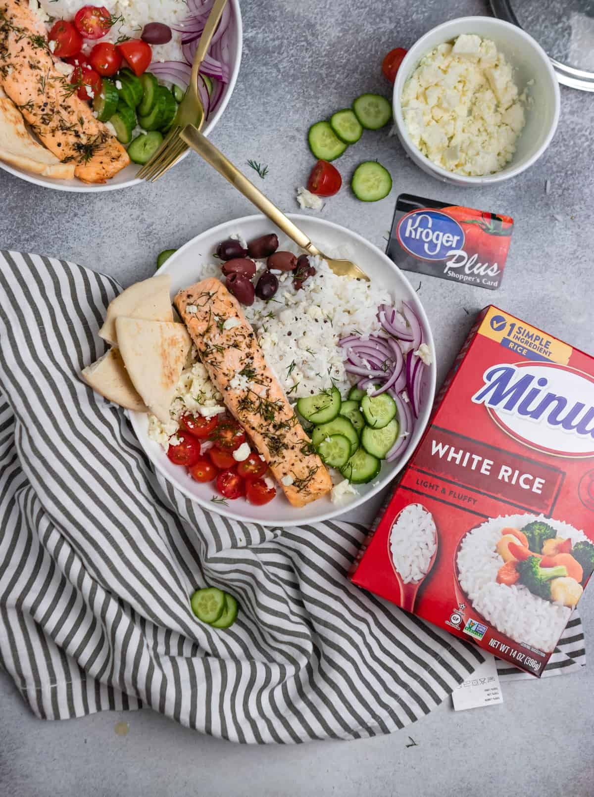 Greek salmon rice bowls with box of minute rice, Kroger card and linens.