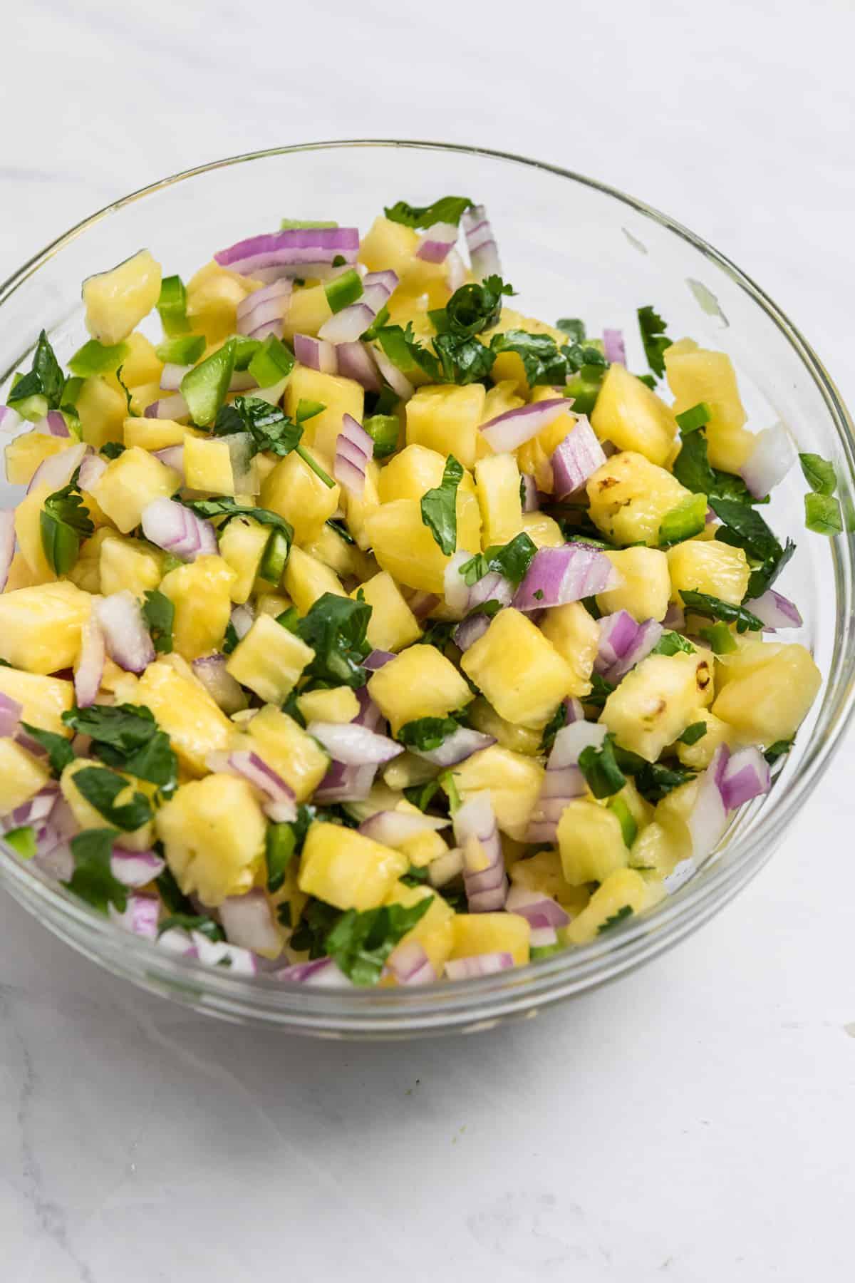 Pineapple salsa in glass bowl.