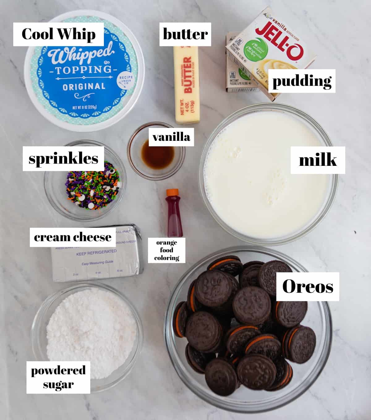 Whipped cream, cream cheese, oreos, pudding and other ingredients labeled on counter.