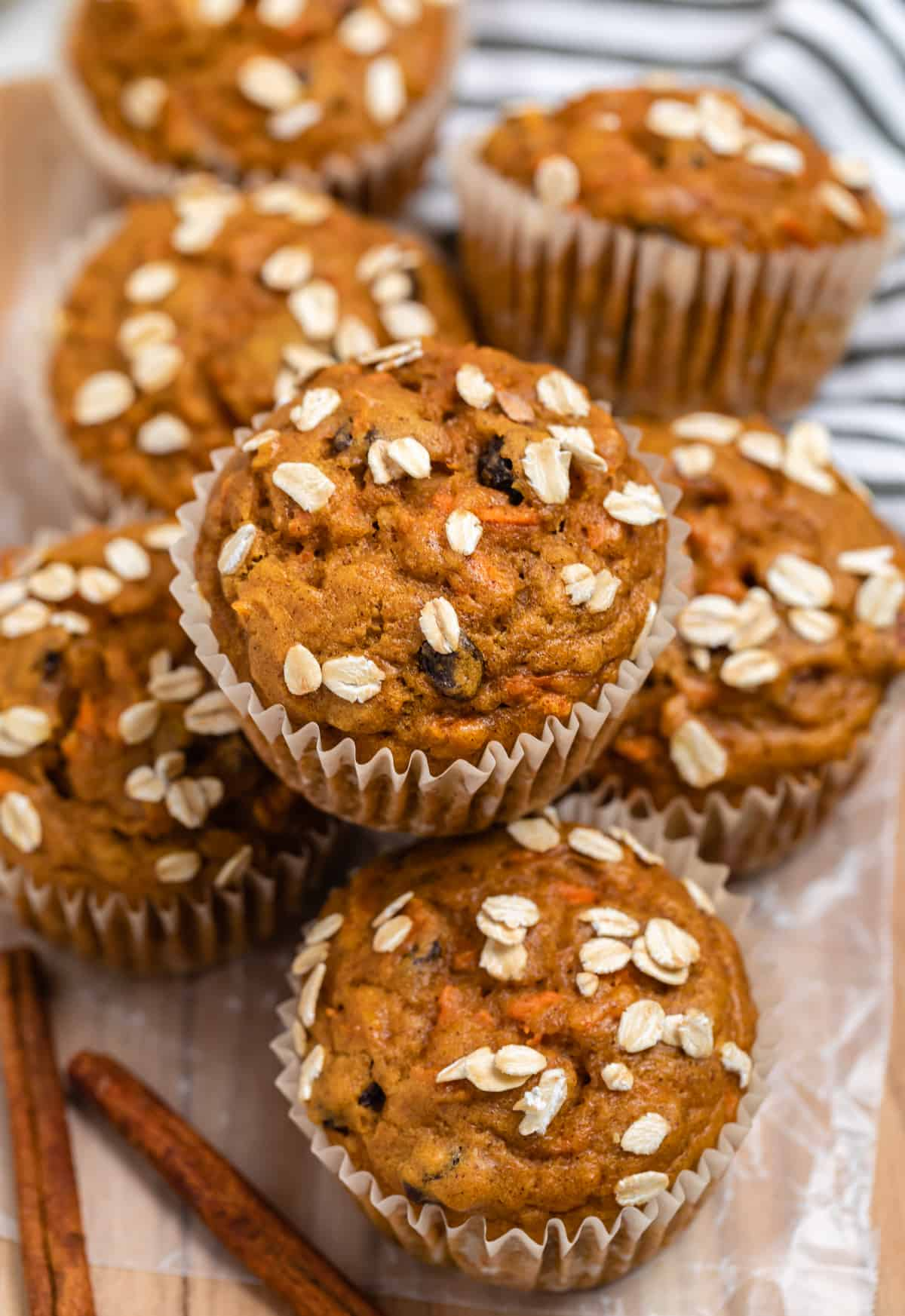 Pumpkin muffins with carrots and oats on top.