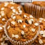 Pumpkin muffins with carrot and oats on top.