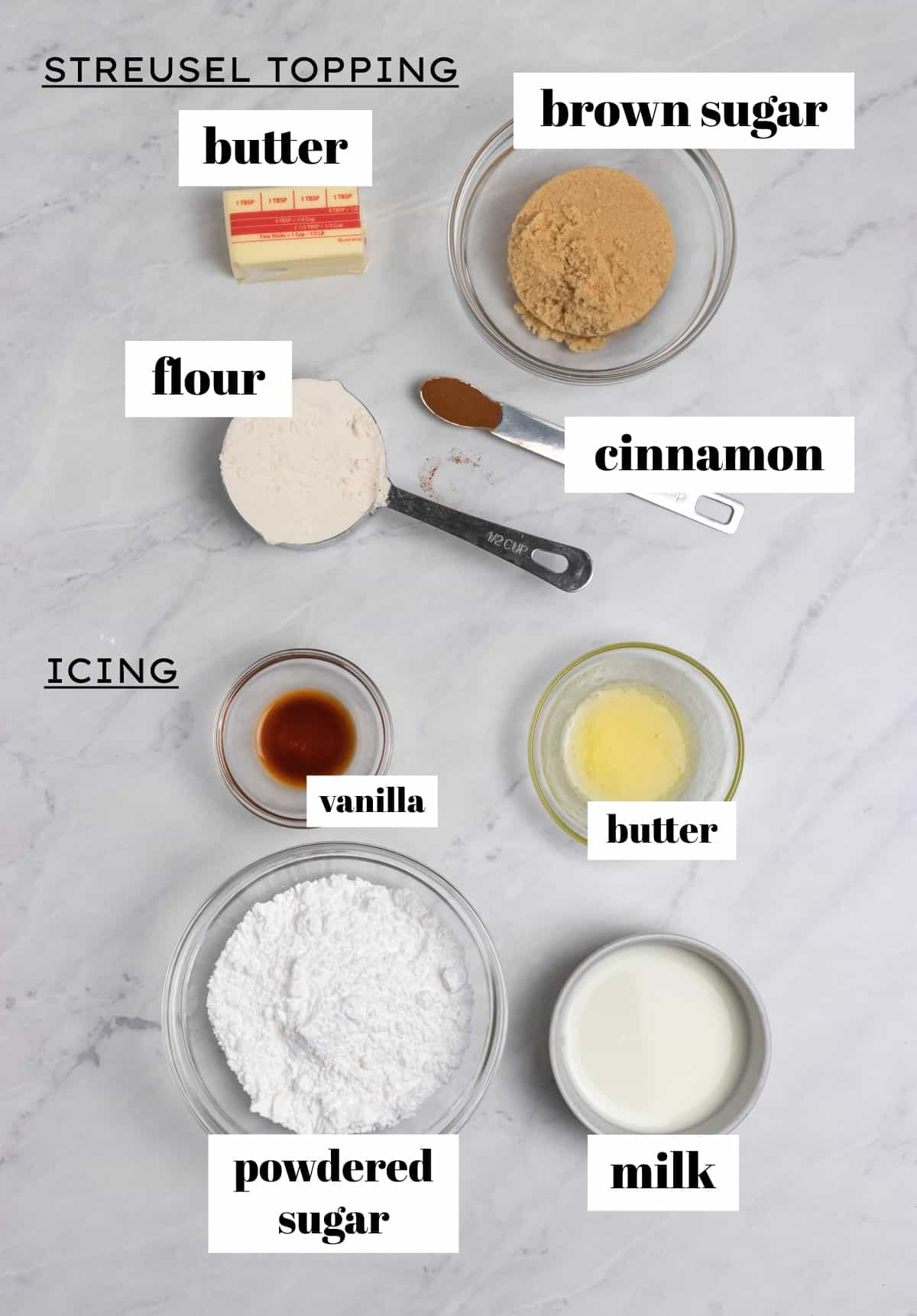 Icing and streusel topping ingredients sorted on counter and labeled.