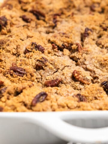 Casserole dish with baked pumpkin French Toast casserole.