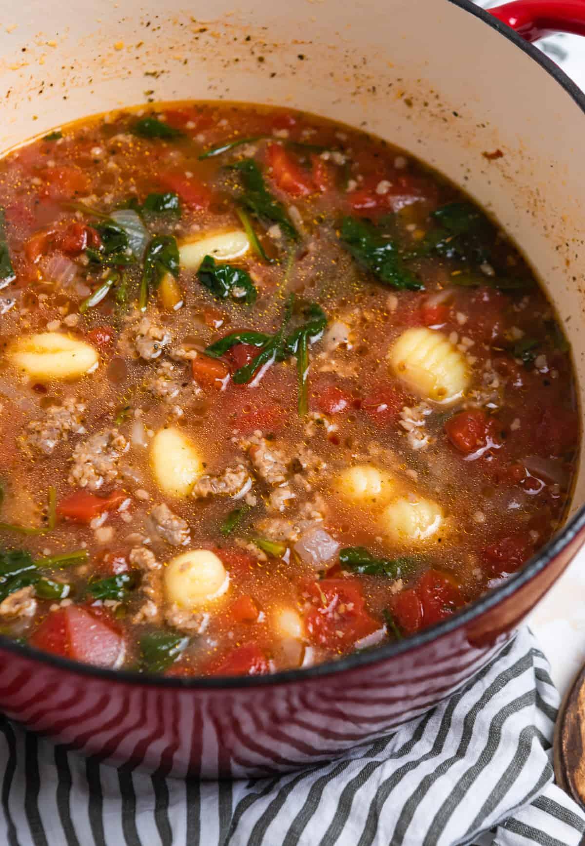 Sausage gnocchi soup in pot.